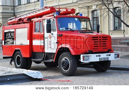 KIEV UKRAINE - MAY 11 2017: Red firetruck Kraz ride on call fire suppression in the city street. Red firetruck.
