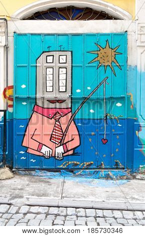 Istanbul, Turkey - April 18, 2017: Closed shop exterior with roller door covered with colorful graffiti near Istiklal Street Istanbul Turkey