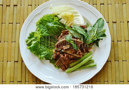spicy minced pork and liver salad on plate