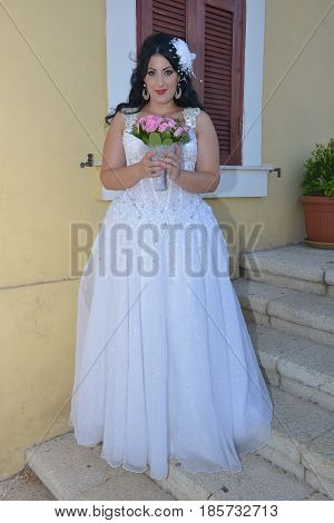 Young bride posing for the camera outdoors