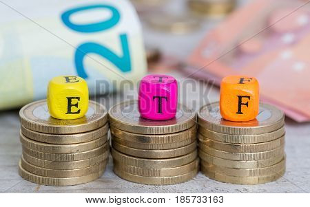 ETF letter cubes on coins concept picture