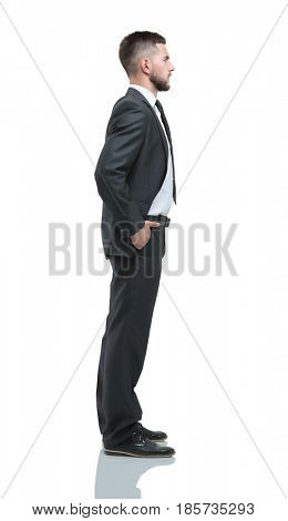 Young business man standing with hands in pocket over white back