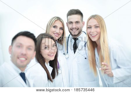 Happy doctors are making selfie using a smartphone and smiling.