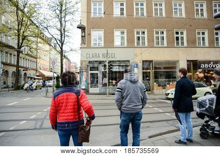 Munich Germany-May 9 2017People cross the street at a pedestrian lamp in downtown Munich