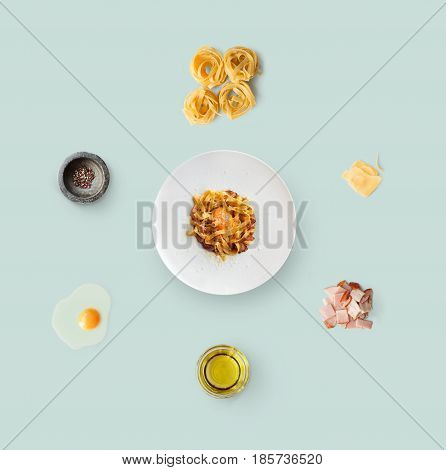 Cooking italian food collage. Ingredients for carbonara pasta, spaghetti, oil, ham, egg and ready dish on plate isolated on blue background