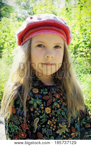 Portrait of a young beautiful girl outdoors on a fall day