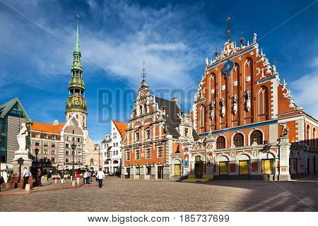 Riga, Latvia - July, 2012: Main square of old town Riga. House of the Blackheads and St. Peter's Church city view.