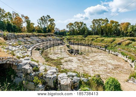 Amphitheater at the Archeological park of Syrakuse, Sicily, Italy