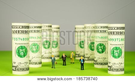 Rolled dollar banknote pillars from dollar money investors and dollar towers