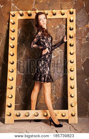 beautiful brunette in black dress