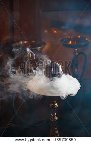 Beautiful smoke in the bowl of a hookah. close-up