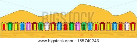 A row of multi coloured beach huts over a beach with sand dunes