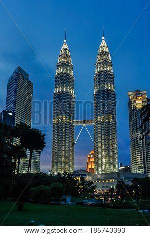KUALA LUMPUR, MALAYSIA - OCTOBER 28, 2012: The illuminated Petronas Towers at night in Kuala Lumpur Malaysia