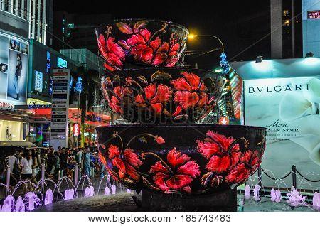 KUALA LUMPUR, MALAYSIA - OCTOBER 28, 2012: Illuminated fountain in the Bukit Bintang shopping area in Kuala Lumpur Malaysia