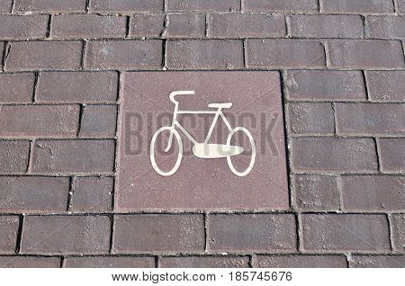 Bicycle lane signage on street. Bicycle sign path on road bikes' lane on outskirts or urban area.