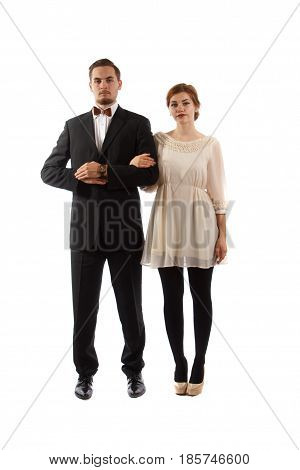 An elegant couple standing on white background