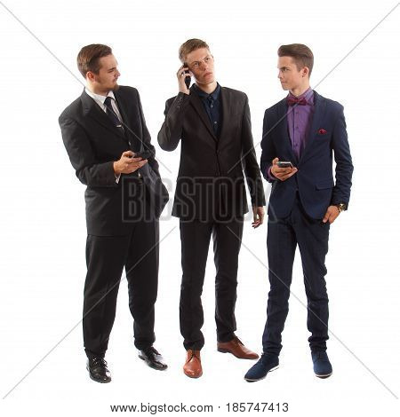 Three well dressed young guys with their phones