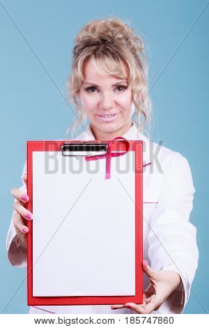 Breast cancer tumor. Mature woman doctor showing red folder with empty white paper for diagnosis. Pink ribbon of awareness on blank file.