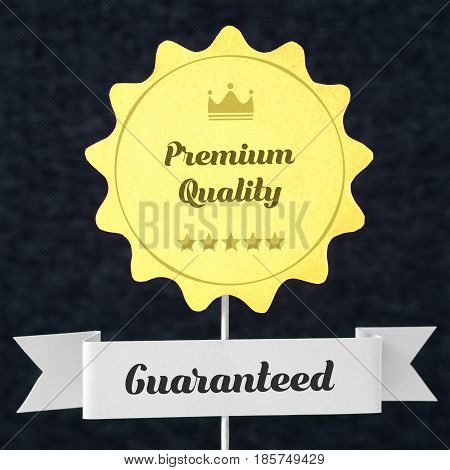 Premium quality guaranteed badge cut from cardboard and paper on a wooden stick. Yellow banner and ribbon for business website to promise customer the best product or service. Seal on dark background.