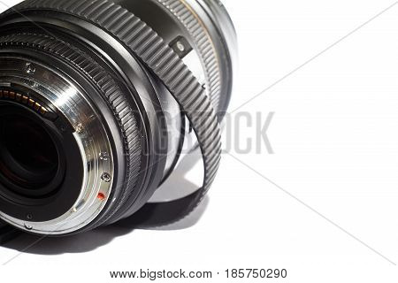 SLR photography lens with stretched over time rubber ring isolated on white background