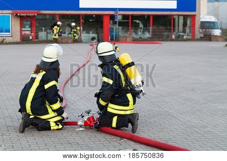 Hamburg, Germany - April 18, 2013: Hdr - Firefighter In Action With Waterhose