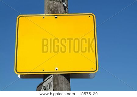 A blank yellow street sign.