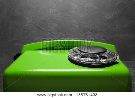 Landline Green Phone On A Gray Wall Background