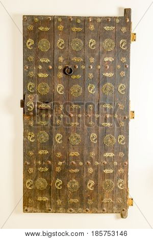 Lugano, Switzerland - 28 April 2017: Isolated old wodden door from india
