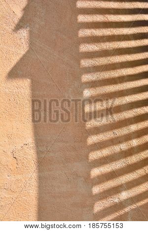 Shade Of Venetian Blind On The Wall.