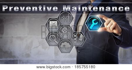 Blue chip services manager is plugging a wrench icon into a virtual Preventive Maintenance control matrix. Industry and technology concept for routine inspection to prevent equipment breakdown.