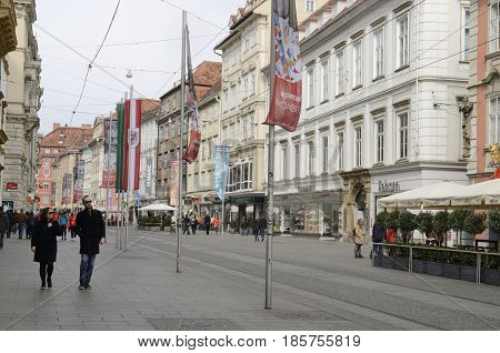 GRAZ, AUSTRIA - MARCH 19, 2017: People strolling along Herrengasse street in Graz the capital of Styria Austria