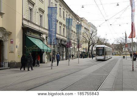 GRAZ, AUSTRIA - MARCH 19, 2017: Tram passing by Herrengasse street in Graz the capital of Styria Austria