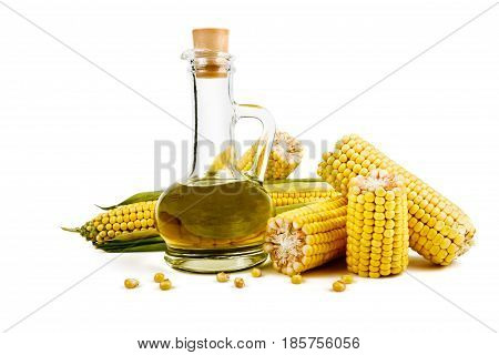 Corn oil in the decanter corn cobs and grain isolated on white background