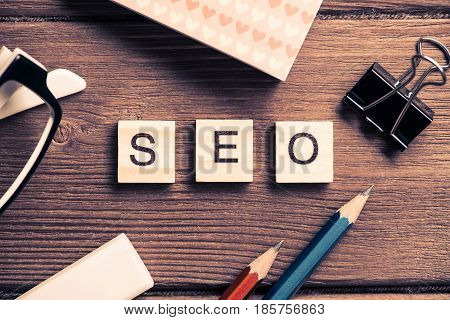Seo word collected of wooden elements, concept of internet optimization