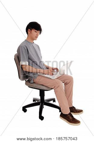 A young man sitting and working hart on his laptop to solve the problem isolated for white background.