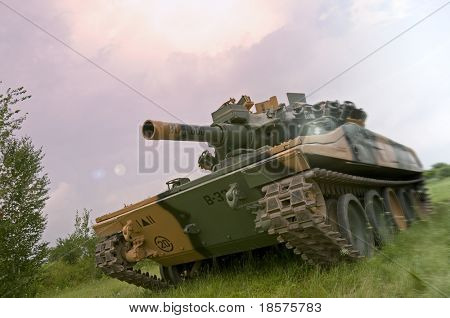 An American M551 Sheridan light tank, armed with the MGM-51 Shillelagh gun-launched missile system, going on the offensive in Vietnam. poster