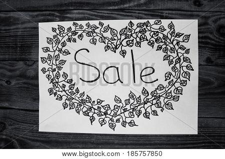 black handmade title SALE on woden background