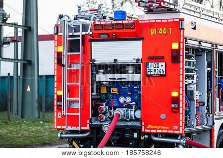 Hamburg, Germany - April 18, 2013: Hdr - Fire Truck With Connected Fire Hose In Action