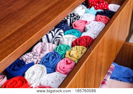 Chest of drawers with multicolored kid's clothes