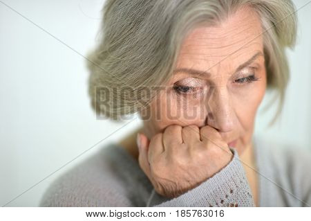 Portrait of a beautiful sad elderly woman close-up