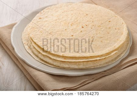 Stack of  wheat flat bread on the plate