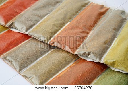Close up of various ground spices packets