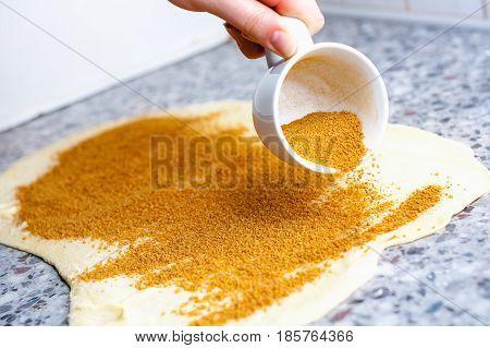 cinnamon bun preparation - dough and shedding cinnamon
