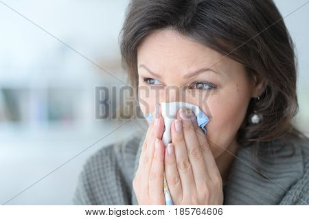 Portrait of a cold young woman with a handkerchief