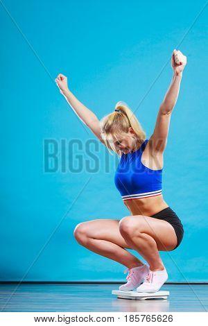Joyful Girl Standing On Weighing Scale