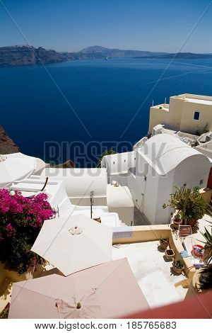 Santorini, Greece - blue sea, blue sky and pink flowers