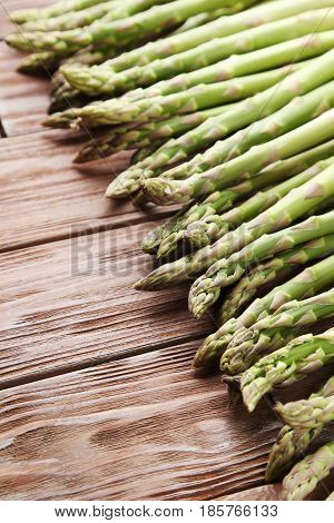 Green asparagus on the brown wooden table