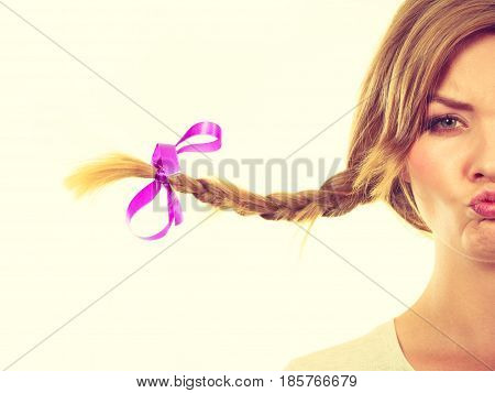 Teenage Girl In Braid Hair Making Funny Face