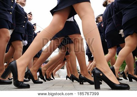 Orel Russia - May 9 2017: Celebration of 72th anniversary of the Victory Day (WWII). Military women marching in short uniform skirts on heels in a row closeup