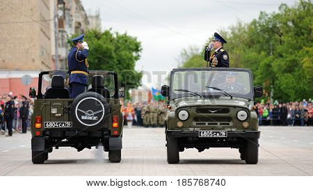 Orel Russia - May 9 2017: Celebration of 72th anniversary of the Victory Day (WWII). Military generals saluting in open cars on empty square before parade horizontal
